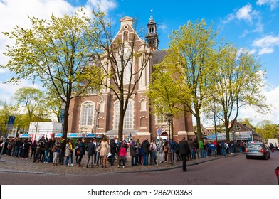 AMSTERDAM-APRIL 30: People stand in a queue to visit the Anne Frank House Museum on April 30,2015.The Anne Frank House Museum is one of Amsterdam's most popular and important museums opened in 1960.