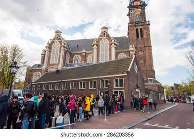 AMSTERDAM-APRIL 30: People and tourists stand in a queue to Anne Frank House Museum on April 30,2015. The Anne Frank House Museum is one of Amsterdam's most popular museums opened in 1960.