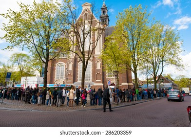 AMSTERDAM-APRIL 30: Tourists stand in a queue to get to Anne Frank House Museum on April 30,2015.The Anne Frank House Museum is one of Amsterdam's most popular and important museums opened in 1960.