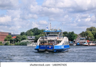 AMSTERDAM-AUG. 8, 2019. Amsterdam North is separated from center by a large canal called the IJ. Three modern Ferryboats provide daily connection between Amsterdam Central Station and Buiksloterweg.