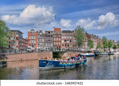 AMSTERDAM-AUG. 8, 2019. Sunny day in the historic Amsterdam Canal Belt. In august 2010 the Amsterdam Canal belt was added as a UNESCO World Heritage site. The canal belt is more than 400 years old.