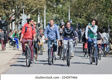 AMSTERDAM-AUGUST 24, 2014. Group of cyclists have fun in Vondelpark. The 47 hectares park has annually around 10 million visitors, it is named after the 17th century author Joost van den Vondel.