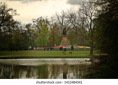 Amsterdam/Holland; 04/30/2016. Vondelmonument (English: Vondel Monument) and a beautiful pond in Vondelpark (English: Vondel Park), Amsterdam, Holland.