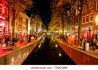 Amsterdam-May 1: Red light district (Wallen) full of people at night on May 1,2015 in Amsterdam, the Netherlands.
