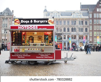 AMSTERDAM,NETHERLAND-DEC 16 ,2017 : Fast food kiosk selling Hot dogs and burgers and drink at Dam Square.