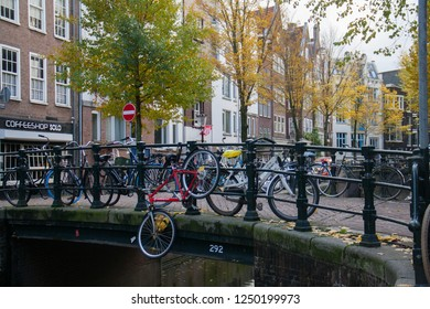 Amsterdam/Netherlands - 11/11/2018: Amsterdam in autumn. Bicycles parked on bridge neare coffeshop