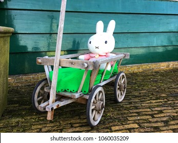 Amsterdam,Netherlands ,21 February 2017; iconic Dutch cartoon rabbit character display in wooden cart in front of the gift souvenir shop