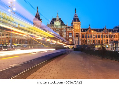 Amsterdam-Netherlands, April 15, 2017 : Light trails of tram in front of  Amsterdam Central Train Station is the central railway station of Amsterdam and is used by 250,000 passengers a day.
