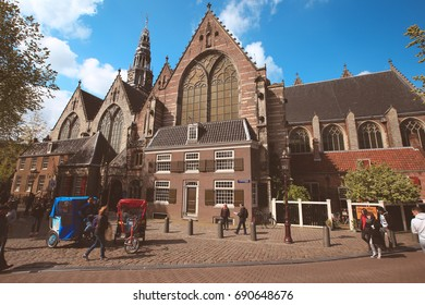 Amsterdam-Netherlands, April 15, 2017 : Oude Kerk (Old Church) and Voorburgwal canal in Amsterdam