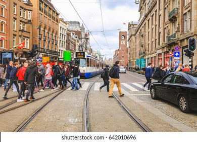 Amsterdam-Netherlands, April 18, 2017 : Street scene with modern tram in Amsterdam, tram is one of the quickest ways to get into and around the city centre