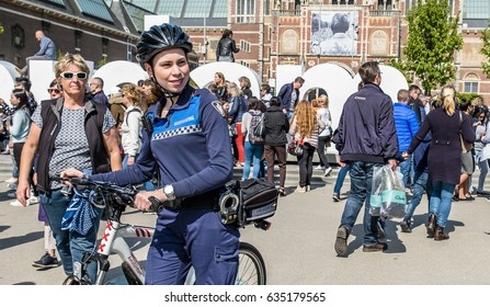 AMSTERDAM/NETHERLANDS - APRIL 31, 2017 : The handhaving police department having a look on the streets of the city