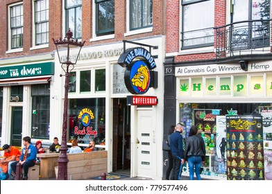 AMSTERDAM,NETHERLANDS: The Bulldog coffeeshop in Amsterdam down town,  young people choose a product on April 27,2015, the Netherlands.