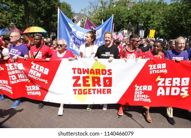 AMSTERDAM,NETHERLANDS - JULY 23,2018: Princess Mabel Van Orange of the Netherlands (C) HIV and AIDS activists take part in the traditional protest march 'Towards Zero Together'