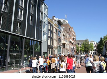 AMSTERDAM,NETHERLANDS - JULY 8,2018: Tourists waiting in line to enter the Anne Franke (1929-1945) Museum during Summer in Amsterdam,Netherlands.