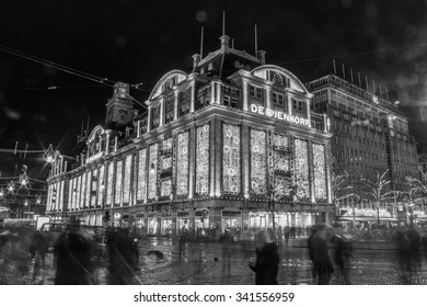 Amsterdam,Netherlands November 19, 2015 : Black and white Long exposure of de Bijenkorf shopping mall  at night on Dam square in Amsterdam