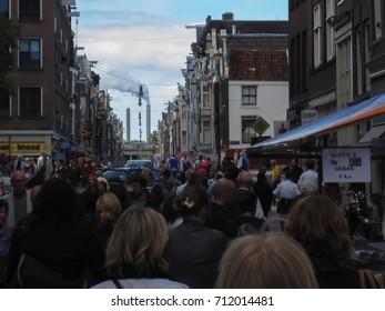 Amsterdam,Netherlands - September 4, 2010: Urban life,people walking on crowded street