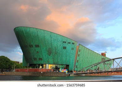 amsterdam,netherlands,7/6/2019,this photo of the nemo science museum building was taken when i was on a boat trip in amsterdam,the striking copper green and shape of the building is adorable.