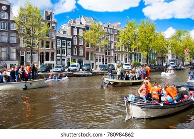 AMSTERDAM,NETHERLANDS-APRIL 27: Amsterdam canal full of boats during King's Day on April 27, 2015, the Netherlands. King's Day is the largest open-air festivity in Amsterdam, the Netherlands.