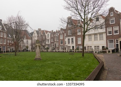 AMSTERDAM/NETHERLANDS-JAN, 31, 2019: View inside the Begijnhof , originally a sanctuary for a catholic lay sisterhood which looked after the poor, secret garden in Amsterdam, The Netherlands.