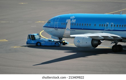 AMSTERDAM/SCHIPHOL, 27 AUGUST 2014 - Boeing airplane from the Royal Dutch Airlines KLM preparing for departure on Amsterdam Airport Schiphol.