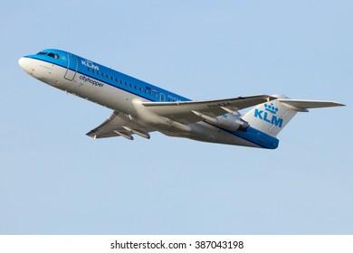 AMSTERDAM-SCHIPHOL - FEB 16, 2016: KLM Cityhopper Fokker 70 take-off from Schiphol airport