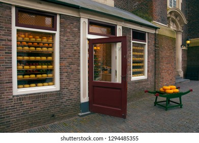 Amsterdam/The Netherlands - January 2012 - Historic Dutch Cheese Shop and Gouda cheese rolls on the window and on a little bench in front of the shop.