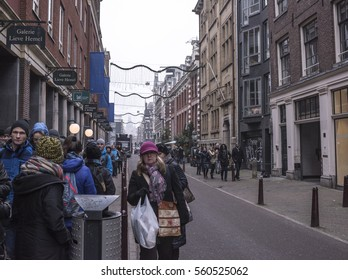 Amsterdam,the Netherlands-December 30,2016:On the street walking people and moving vehicles