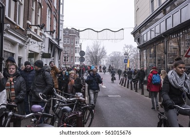 Amsterdam,the Netherlands-December 30,2016:On the street walking people