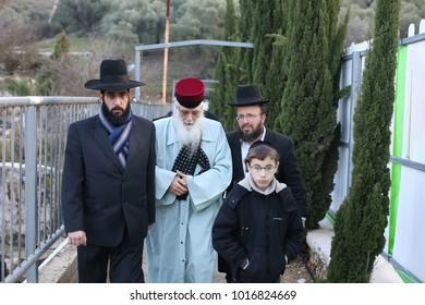 AMUKAH, ISRAEL - JAN 31, 2018: Rabbi Yechiel Abuchatzira (Abesera) prays with other jewish men at the tomb of Rabbi Yonatan ben Uziel in Amukah, Israel
