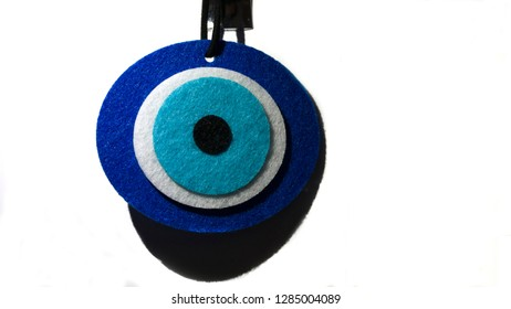 Amulet isolated on white background. Traditional evil eye talisman amulet. Good luck charm to protect against the evil eye. Turkish culture traditional faith symbol.