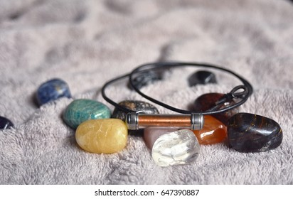 An amulet and stones