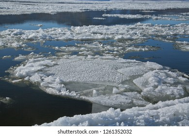 Amur river frozen, sludge in dark blue water, late autumn in Amurskaya oblast, the Far East region on the border with China.