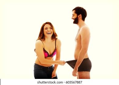 Amused woman looking into man's panties.