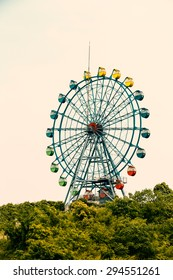 Amusement park ferris wheel in the sky
