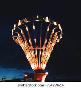 Amusement park at night lights movement