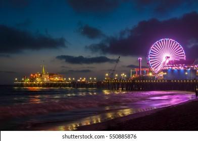 Amusement park on the pier in Santa Monica at night, Los Angeles, California, USA