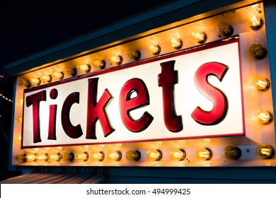 Amusement Park Ride Ticket Booth Sign at Night With Lights