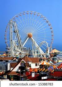 Amusement park rides against blue sky