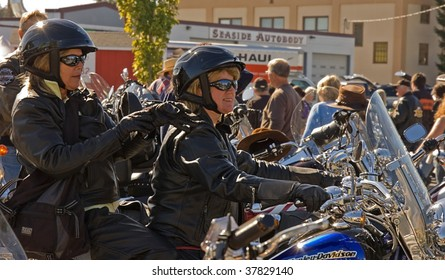 ANACORTES, WA - SEPTEMBER 27: Two unidentified women participants in the 28th annual Oyster Run largest motorcycle run in the Pacific Northwest on September 27, 2009 in Anacortes, WA.