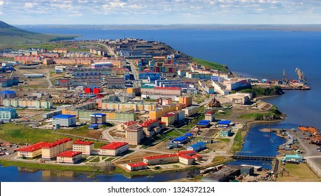 Anadyr is the administrative center of Chukotka and the most eastern city of Russia. Summer landscape with the northern city. Aerial photo of colorful buildings and nature. Far East, Siberia, Arctic.