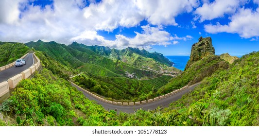 Anaga Mountains, Tenerife, Canary islands, Spain: Taganana and serpantine road in green mountains with horizon landscape near shore of Atlantic ocean