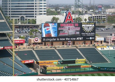 ANAHEIM - APRIL 26: Early arriving fans stroll under the giant scoreboard as they await a spring contest at Angels Stadium of Anaheim on April 26, 2007 in Anaheim, California.