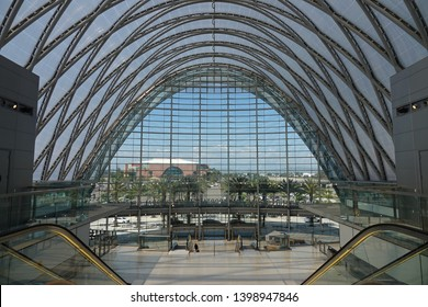 Anaheim, CA / USA - May 12, 2019: The interior of the Anaheim Regional Transportation Intermodal Center ( aka ARTIC ) is shown during a sunny day, with the Honda Center arena visible in the distance.