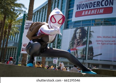 ANAHEIM, CALIFORNIA - APRIL 4 2015: A woman cosplaying Marvel's Spider-Gwen poses in front of the entrance to WonderCon Anaheim.