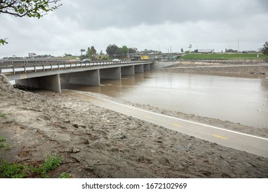 Anaheim, California/United States - 03/13/2020: A view of the Santa Ana River during a rain storm. The water level is rising in the channel.