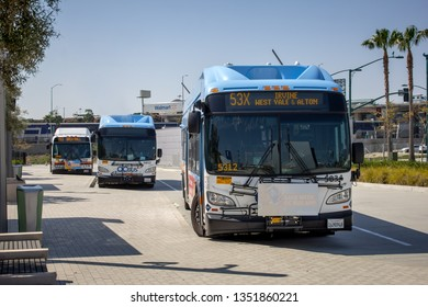 Anaheim, California/United States - 03/25/19: Three OCTA buses parked at the ARTIC