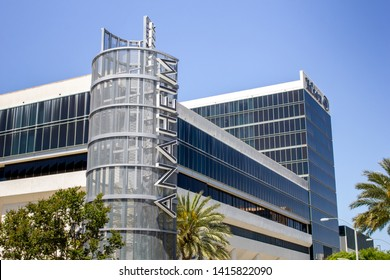 Anaheim, California/United States - 04/24/2019: A center pillar icon for the Anaheim Resort area, with Hilton Anaheim Hotel in the background