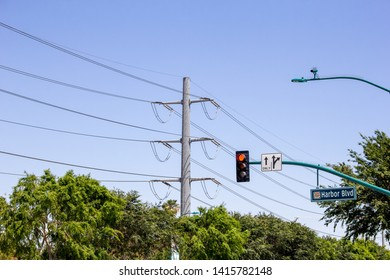 Anaheim, California/United States - 04/24/2019: A large metal utility pole looms in the background of a street intersection