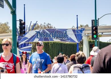 Anaheim, California/United States - 04/24/2019: Tourist walk across the street towards Disneyland theme park