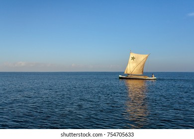 Anakao, Madagascar, october 21, 2016: A traditional outrigger canoe sailing off Anakao in southern Madagascar